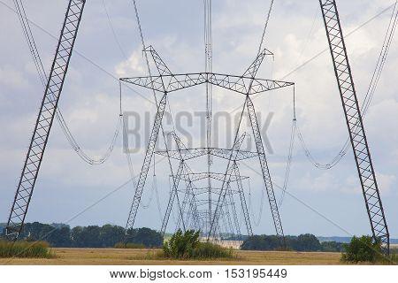 High voltage electrical power line over blue sky