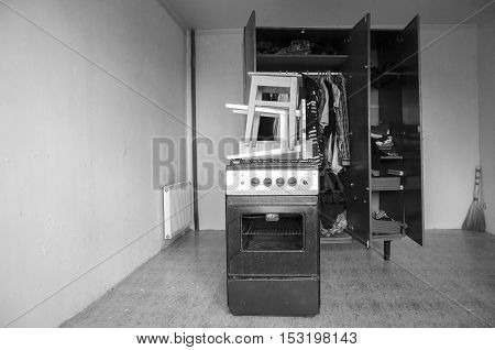 Room with stools, old gas stove and closet. Black and white photography