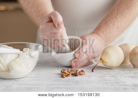 Man In The Kitchen Preparing A Dressing With Spices