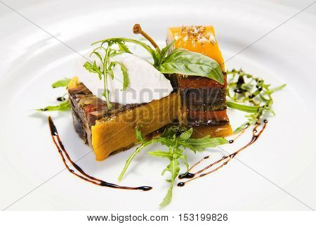 Delicious foie gras served on white plate