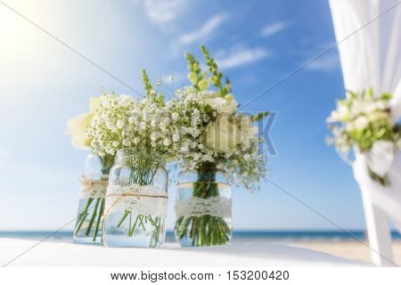 Bunch of flowers for a wedding ceremony. On the background of the sky.