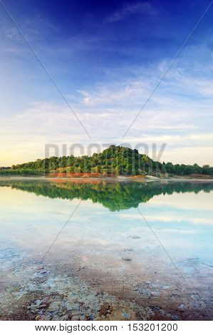 Lake and spring green hills. Composition of nature