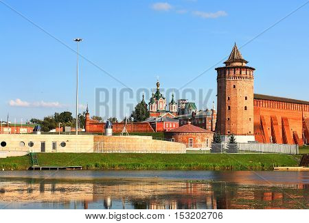 View of the ancient Russian Kremlin with fortress wall and cathedrals from the bank of the Moscow River