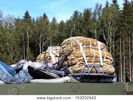 Arranged cargo parachutes for airdrop on military equipment loading on the plane for airdrop