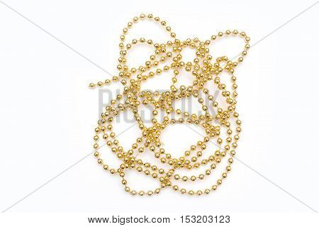 Gold beads isolated on white background. Christmas decorations