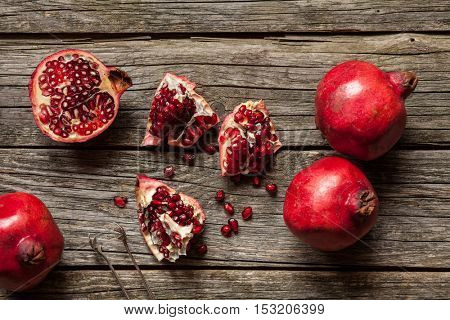 Pomegranates on wooden table