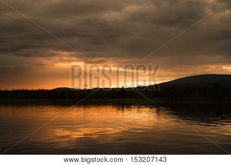cloudy dramatic sunset on the lake in Finland