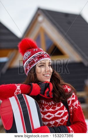 Woman snowboarder on the slopes frosty winter day. Beautiful girl on snoborde in the snow.