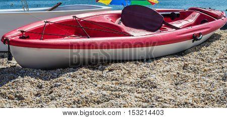 the red boat on sea rocks Atlantic ocean