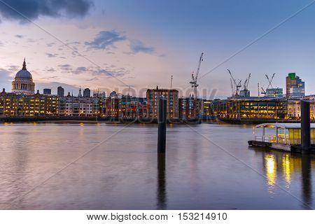 Night skyline of city of London and Thames river, England, Great Britain
