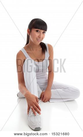 Beautiful Smiling Woman Sitting On The Floor