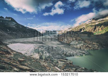 Rhone glacier in Swiss Alps in summer day. Switzerland, Europe. Toned like Instagram filter