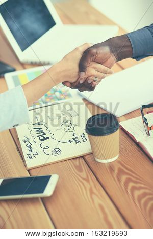 Business people handshake , sitting on the desk in office