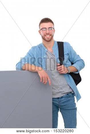 Portrait of a smiling male student holding blank board
