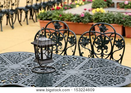 vintage lantern with chairs and tables, outdoor cafe