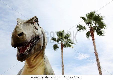 Close up of dinosaur and sky background