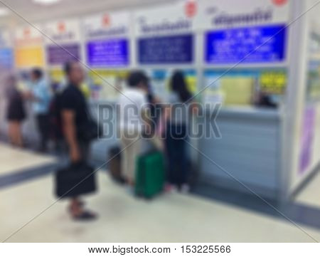 Abstract blur people buy ticket at  Bangkok Bus Terminal (Sai Tai Mai)