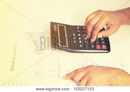 Hand of accountant checking financial document with sun light