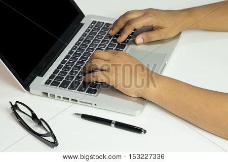Closeup Of Hands Typing On Laptop Computer