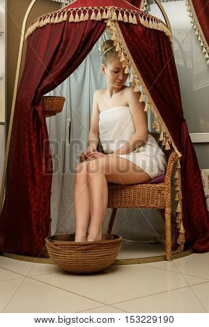 Caring about beauty. Relaxed woman posing in spa salon