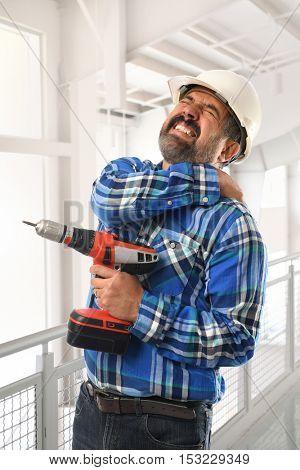 Hispanic man suffering back injury at work