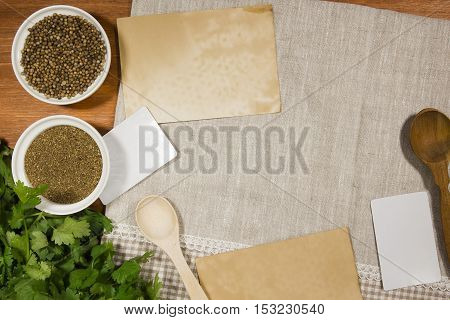Coriander seeds ground and green on a linen napkin