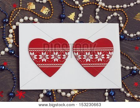 New Year's card with a beads confetti and red decorative elements in the form of heart. Christmas background. The letter for Santa.