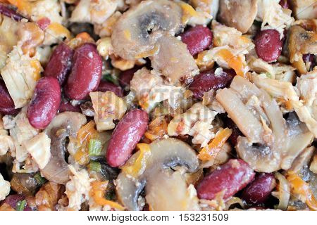 Russian Salad with bean mushrooms and meat for background