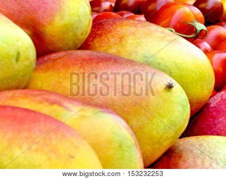 Mango and tomato on bazaar in Tel Aviv Israel July 12 2012