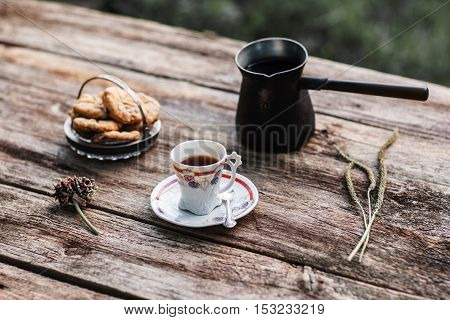 Coffee with cookies on wooden table, free space. Traditional coffee break with pastry, rustic style. Autumn, warming drink concept
