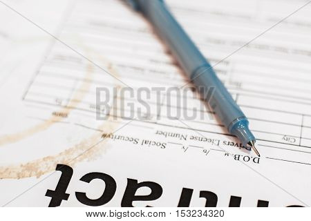 Pen on dirty contract paper close-up, business background. Close-up of documents of busy, and tired businessman.