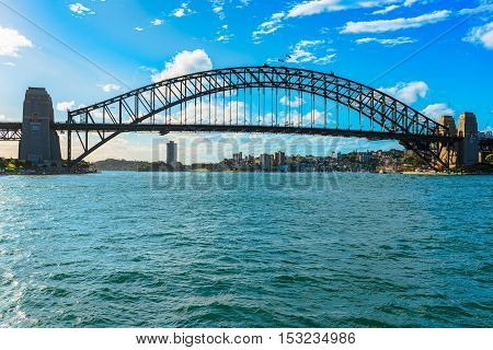 Sydney Harbour Bridge Sydney Australia. The Sydney Harbour Bridge is a steel through arch bridge across Sydney Harbour that carries rail, vehicular, bicycle, and pedestrian traffic between the Sydney central business district (CBD) and the North Shore.