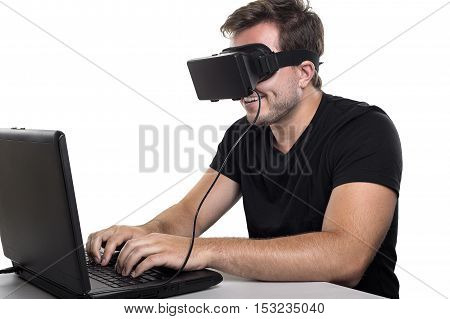 Virtual Reality gamer wearing headset tethered to a gaming pc