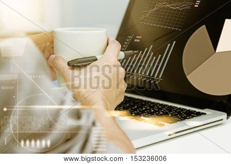 Using Computer In Office With A Cup Of Coffee,young Woman Working On A Laptop Computer While Enjoyin