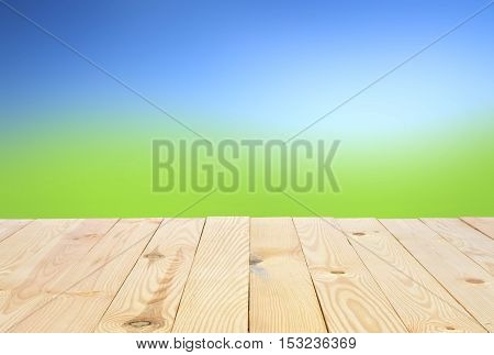 diagonal view or 45 (forty five) degrees modern and classic vertical wood table or floor for your place object or product on meadow with blue sky background isolated included clipping path