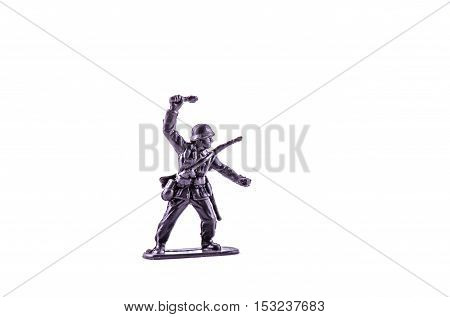 miniature toy plastic soldier  on white background