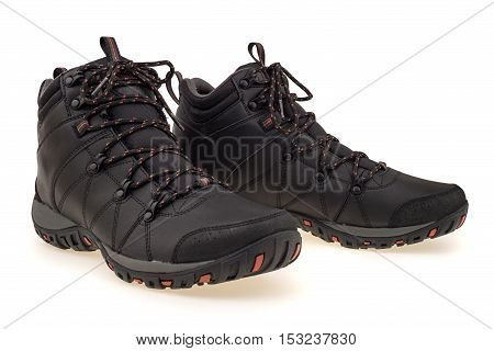 A pair of new hiking boots on white background. Isolated on white background.
