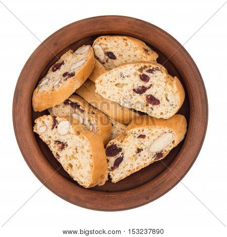 Cookies with raisins in a ceramic plate. Isolated on white background. Top view.