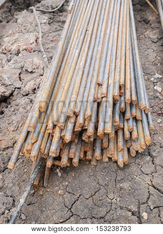 Steel rods or bars used to reinforce concrete in construction