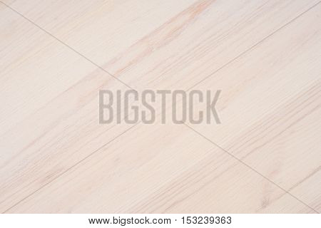 White soft wood surface as background. Top view.