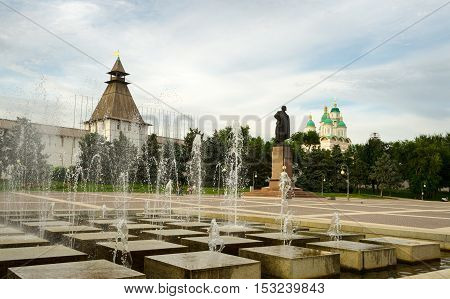Astrakhan summer evening. Lenin square with a fountain. Astrakhan Kremlin and the Assumption Cathedral in the background
