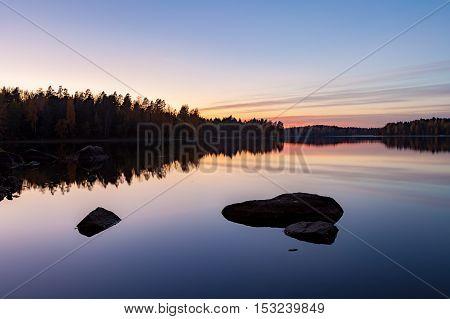 Serene view of calm lake at twilight