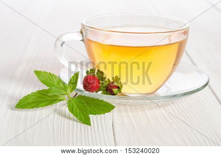 Cup Of Tea And Strawbarries On The White Wooden Table