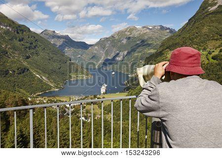 Norwegian fjord landscape. Geiranger village landscape. Cruise travel. Viewpoint. Tourist