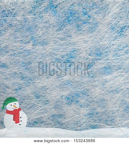 Grey fiber fabric and blue glitter film and snowman, background