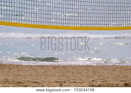 grid of beach volleyball closeup against the background of the sea and the sandy coast