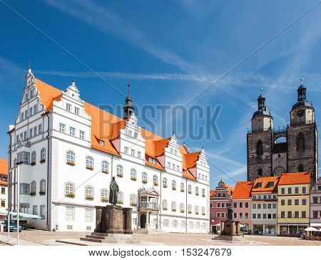 Market square in Wittenberg main square of old german town. Monuments of Martin Luther and Philipp Melanchthon. Wittenberg is Luther City in Germany UNESCO World Heritage Site