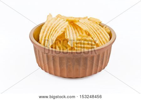 earthenware bowl with crinkle cut potato crisps isolated on a white background