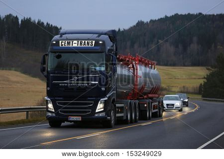 SALO FINLAND - OCTOBER 22 2016: Dark blue Volvo FH tank truck of Cemt-Trans moves uphill along highway in South of Finland late in the evening.