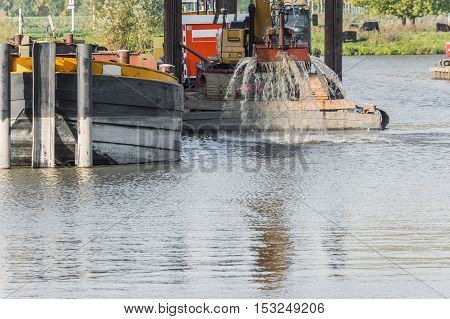 Dredging in the harbor basin for a deeper harbor.